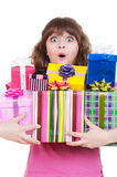 Amazed girl with gift boxes Stock Photography