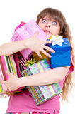 Amazed girl with gifts. Portrait of amazed girl with gifts. isolated on white background Royalty Free Stock Image