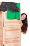 Amazed girl hiding. Behind clothes screen Stock Photo
