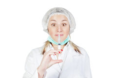 Amazed girl nurse with injection Royalty Free Stock Photos