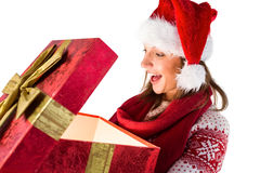 Amazed girl opening a magical christmas gift Stock Images