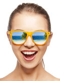 Amazed girl in shades. With beach reflection Royalty Free Stock Images