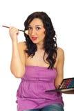 Amazed girl using blush Royalty Free Stock Image