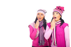 Amazed girls in pink woolen clothes royalty free stock photo