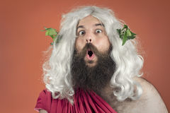 Amazed God. Amazed zeus god or jupiter against orange background Royalty Free Stock Photo