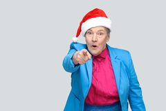 Amazed grandmother in colorful casual style, blue suit and chris Royalty Free Stock Photos