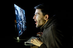 Amazed guy emotional playing computer game Stock Photography