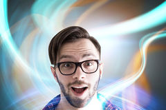 Amazed guy in glasses, abstract background Stock Images