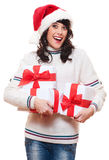 Amazed happy woman in santa hat Stock Image