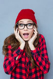 Amazed hipster woman looking at camera Stock Photo