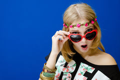 Amazed hipster woman in sunglasses Stock Image
