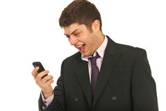 Amazed by his phone mobile Royalty Free Stock Image