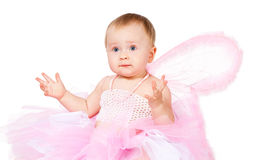 Amazed infant girl in fairy attire isolated Stock Photography