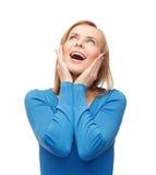 Amazed junge Frau lachend Stockbild