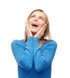 Amazed laughing young woman Stock Image