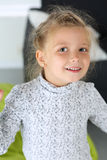 Amazed little blonde girl looking in camera portrait Royalty Free Stock Photos