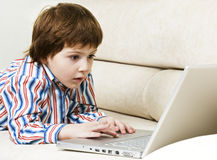 Amazed little boy with laptop Stock Photography
