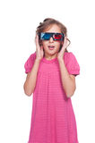 Amazed little girl in 3d glasses. Isolated on white background royalty free stock images