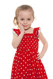 Amazed little girl in a red dress Royalty Free Stock Photography