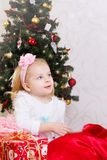 Amazed little girl under Christmas tree Stock Images