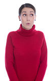 Amazed looking young woman in red pullover - isolated over white Stock Image