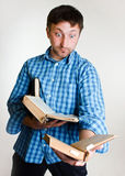 Amazed man with books in hand Stock Image