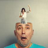 Amazed man with businesswoman. Amazed senior men with open head. young emotional businesswoman standing into the head, looking at the men and screaming with Stock Images