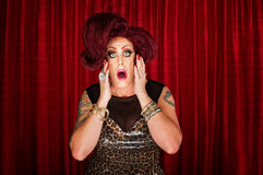 Amazed Man in Drag. Amazed drag queen with tattoos in theater Stock Photo