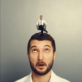 Amazed man with happy successful man. Portrait of amazed man with happy successful man on the head Stock Image