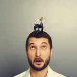 Amazed man looking at bored man. Over dark background Royalty Free Stock Photography