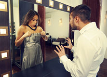 Amazed man looking at woman. Amazed men looking at women in the mirror Royalty Free Stock Photo