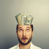 Amazed man with money in the head Stock Photography