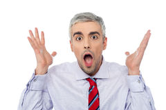 Amazed man with open mouth. Excited aged man over white background Royalty Free Stock Images