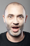Amazed man portrait isolated on gray Stock Photos