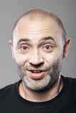 Amazed man portrait isolated on gray Royalty Free Stock Photo