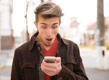 Free Amazed Man Reading Phone Outside Stock Photography - 119578192