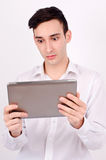 Amazed man reading from a tablet. Royalty Free Stock Photo