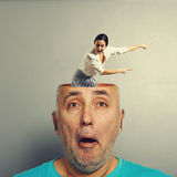 Amazed man with screaming woman. Amazed senior men with open head. young screaming businesswoman standing in the head, looking at the men and pointing at Stock Photos