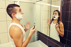 Amazed man shaving Stock Images