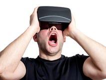 Amazed man using virtual reality glasses isolated on white backg Stock Photo