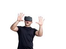 Amazed man using virtual reality glasses Royalty Free Stock Photos