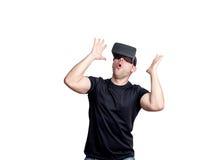 Amazed man using virtual reality glasses Stock Photo