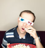 Amazed man watching a movie Stock Photography