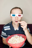 Amazed man watching a movie Stock Images