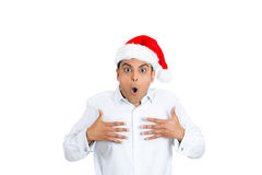 Amazed man wearing santa's hat with wide open eyes and mouth. Royalty Free Stock Images