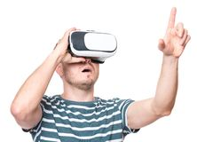 Man with VR glasses. Amazed man wearing virtual reality goggles watching movies or playing video games gesticulating hands, isolated on white background Stock Photography