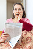 Amazed mature woman with newspaper Stock Images
