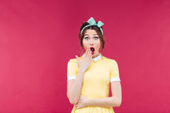 Amazed pretty pinup girl standing with mouth opened Stock Photos