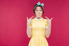 Amazed pretty pinup girl standing with mouth opened Stock Photo