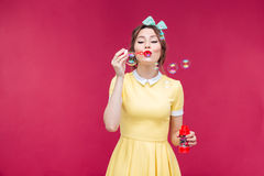 Amazed pretty pinup girl standing with mouth opened Stock Image